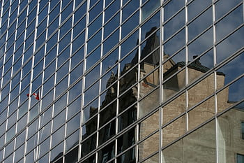 glass-building-city-wall-reflection-flag-royalty-free-thumbnail.jpg